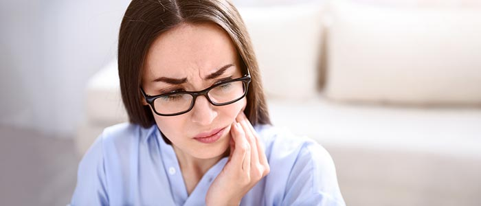 Chiropractic Irvine CA Woman Suffering with TMJ